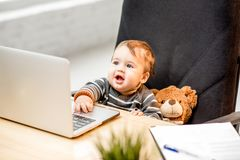 Baby boss at the office stock photos