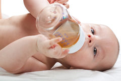 Baby with bottle. On a white background Stock Images