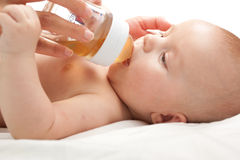 Baby with bottle. On a white background Royalty Free Stock Images