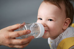 Baby and the bottle Royalty Free Stock Photos