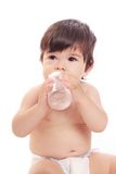 Baby with bottle. Isolated on white Royalty Free Stock Images