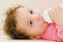 Baby with bottle. A baby with a bottle of milk Stock Photo