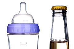 Baby bottle and beer bottle on white Stock Photos