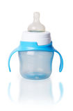 Baby bottle with blue plastic handles Stock Photos