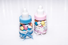 Baby bottle with candies. Baby bottle with colorful candies Royalty Free Stock Photos