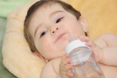 Baby with bottle closeup Stock Photography