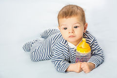 Baby and bottle Royalty Free Stock Images