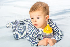 Baby and bottle Stock Images