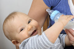 Baby bottle feeding Royalty Free Stock Images