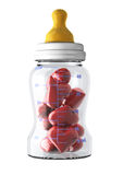 Baby bottle filled with hearts Royalty Free Stock Photo