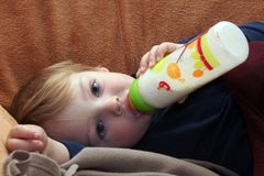 Baby with bottle Royalty Free Stock Photo