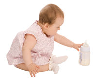 Baby and bottle with milk Stock Photo