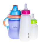 Baby bottle with milk and baby water cup Royalty Free Stock Photography