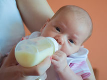 Baby and bottle 3 Royalty Free Stock Images