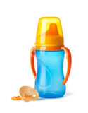 Baby: bottle and pacifier. On a white background stock photography