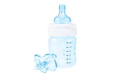 Baby bottle and pacifier Stock Images