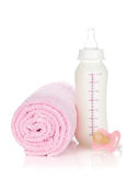 Baby bottle, pacifier and towel Stock Photo