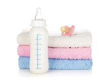 Baby bottle, pacifier and towels Royalty Free Stock Photos