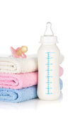 Baby bottle, pacifier and towels Stock Photography