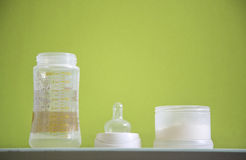 Baby bottle pieces Stock Photography