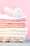 Baby Bottle and Pink Clothes Royalty Free Stock Photography