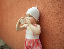 Baby with a bottle of water. Baby girl holds a bottle of water Royalty Free Stock Image