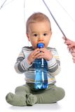 Baby with bottle of water. And mums hand Royalty Free Stock Photos