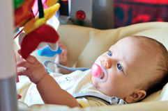 Baby  in bouncer chair Royalty Free Stock Images