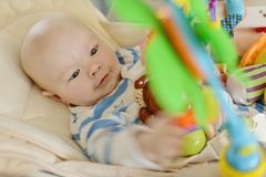 Baby  in bouncer chair Royalty Free Stock Image