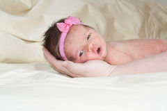 Baby With A Bow Royalty Free Stock Photos