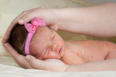 Baby With A Bow Royalty Free Stock Photo