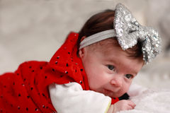 Baby with bow thigh Royalty Free Stock Photography