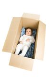Baby in the box. A photo of baby lying in the box Royalty Free Stock Images