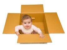 Baby in a box. Beautiful happy baby in a cardboard box Royalty Free Stock Images