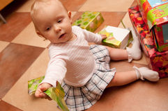 Baby on box presents Stock Photos