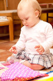 Baby on box presents Stock Images