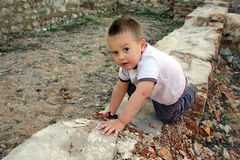 Baby boy. Playing in the dangerous place Stock Image