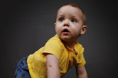Baby Boy. Beautiful baby boy poses on a black background royalty free stock image