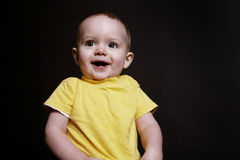 Baby Boy. Beautiful baby boy poses on a black background royalty free stock photography