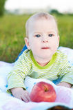 Baby boy. Cute baby boy lying on tummy. outdoor shot Stock Photography