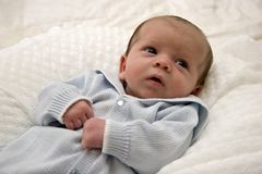 Baby Boy. Dressed in Blue Knit stock photos
