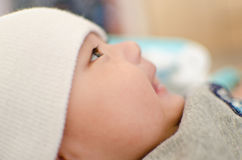 Baby boy. A side view of a smiling baby looking forward stock photo
