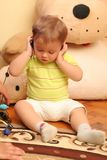 Baby boy. Little blond baby boy listening music on headphones stock image