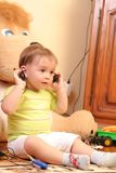 Baby boy. Little blond baby boy listening music on headphones stock images