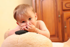 Baby boy. Little blond baby boy playing with toys at home royalty free stock photos