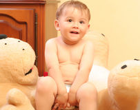 Baby boy. Little blond baby boy playing with toys at home stock images