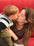 Baby boy. Little blond baby boy kissing her mother Stock Photography
