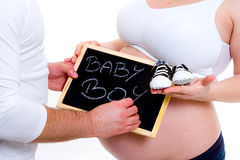 Baby boy. Couple with blackboard waiting for a baby boy Royalty Free Stock Photography