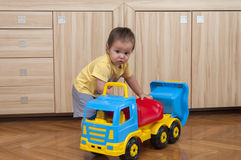 Baby boy. Play with truck toy Royalty Free Stock Photos