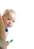 Baby boy. Adorable little baby looking out the armchair royalty free stock image